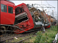 An express train lies overturned on the ground as heavy winds from typhoon Shanshan blew the carriages off the track, Kyushu 17 September 2006.