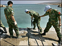 UN peacekeeping engineers from China work in the port in the southern Lebanese city of Naqoura - 17/8/06