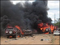 Burning cars outside Somalia's parliament