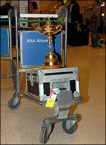 The Ryder Cup sits on a luggage trolley at Heathrow
