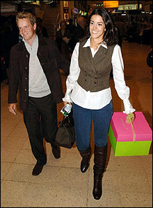 England's Luke Donald and girlfriend Diane Antonopoulos arrive at Heathrow
