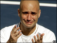 Andre Agassi cries after playing his last match before retirement, September 2006