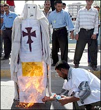 Iraqis burn an effigy of Pope Benedict during a demonstration in Basra.