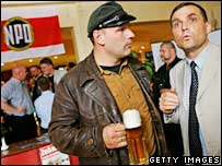 NPD's candidate in Schwerin, Thomas Wulff (left), and NPD leader Udo Pastoers celebrate after elections