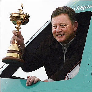 Woosnam holds the Ryder Cup aloft from the cockpit of the plane