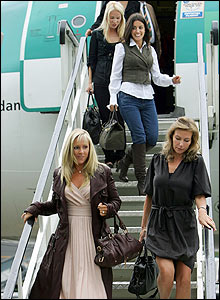 The wives and girlfriends of the European team leave the plane