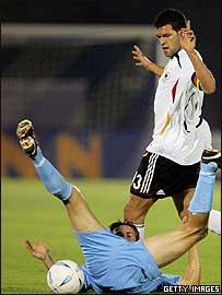 Germany's Michael Ballack tangles with San Marino's Manuel Marina