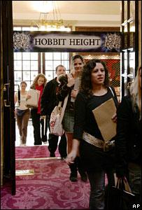People pass under hobbit height marker