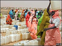 Women queue for water near Al-Fasher, the capital of the Darfur region
