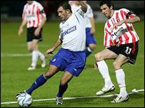 Greg O'Halloran shields the ball from Derry's Killan Brennan