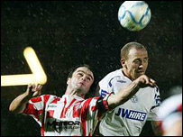 Darren Kelly (left) and Shelbourne's Glenn Crowe battle to win the ball