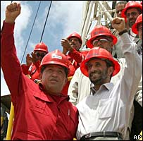 Venezuelan President Hugo Chavez and Iranian leader Mahmoud Ahmadinejad wearing hard hats