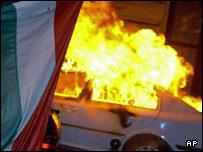A car burns in Budapest after a night of protests