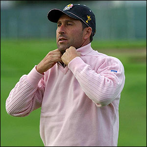 Jose Maria Olazabal adjusts his sweater