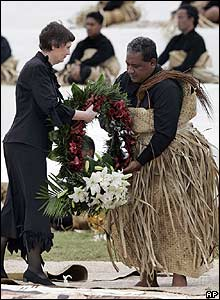 New Zealand PM Helen Clark hands a wreath to the royal undertaker