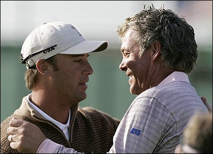 Chris DiMarco greets Darren Clarke