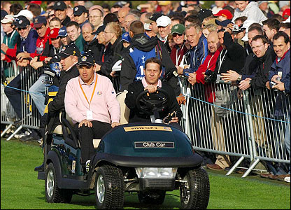 Europe's Padraig Harrington arrives at the driving range in a buggey