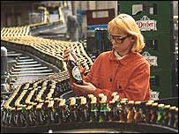 Woman in beer bottling plant