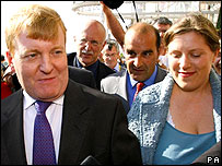 Charles Kennedy arrives at the conference hall with his wife, and media scrum in tow