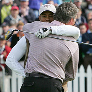 Woods and Clarke share an emotional embrace