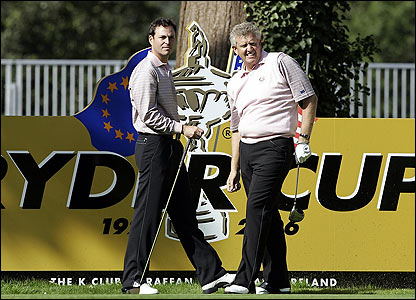 David Howell and Colin Montgomerie stand on the tenth tee
