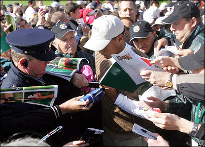Woods is mobbed by autograph hunters