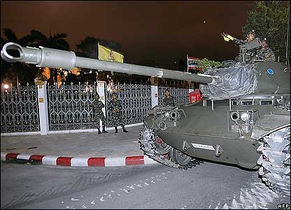 Thai soldiers ride in tanks next to Government House in Bangkok