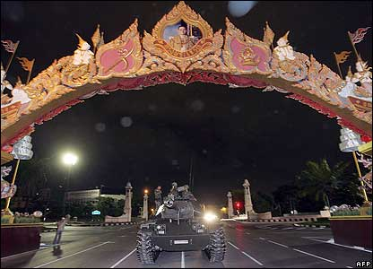 Thai soldiers stand guard on military tanks in front of the Government House in Bangkok