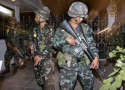 Thai soldiers stand guard at the Government House in Bangkok