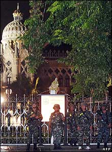 Troops stand guard outside Government House in Bangkok