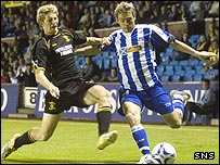 Killie forward David Fernandez takes on Jason Thomas