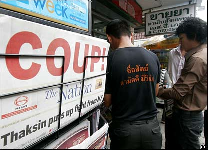Newspaper readers gather for the latest editions in downtown Bangkok