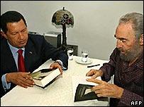 Hugo Chavez (l) with Fidel Castro (r)
