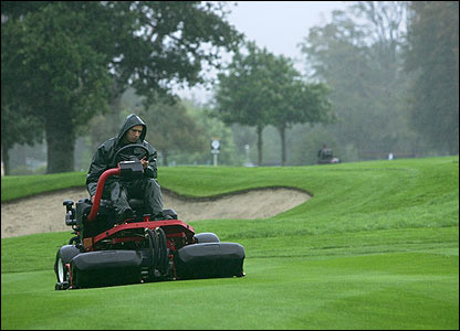 A member of groundstaff mows the fairway