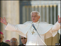 Pope Benedict XVI waves to faithful in St Peter's Square at the Vatican during his weekly general audience