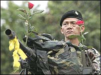 Thai soldier near Government House in Bangkok, with roses received from a wellwisher
