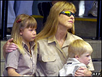Terri Irwin, Steve Irwin's wife, sits with daughter Bindi (L) and son Bob at the memorial service