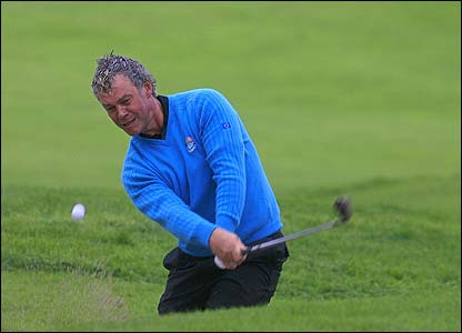 Europe's Darren Clarke plays out of a bunker