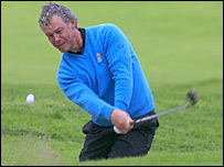 Europe's Darren Clarke chips out of the bunker during practice