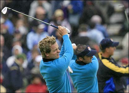 Luke Donald and Paul McGinley practice on the driving range