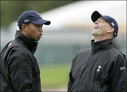 Tiger Woods shares a joke with US team captain Tom Lehman