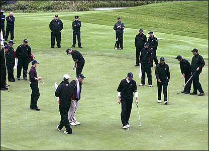 The US team practice on the first green