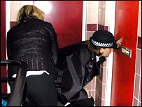 police and welfare officer check on flat