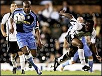 Jermaine Easter (left) takes on Fulham's Gabriel Zakuani