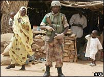 African Union soldiers patrol the village of Kerkera, northern Darfur