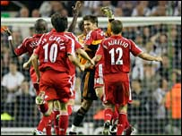 Xabi Alonso is congratulated after his spectacular strike