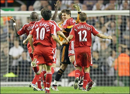 Xabi Alonso is mobbed by his team-mates