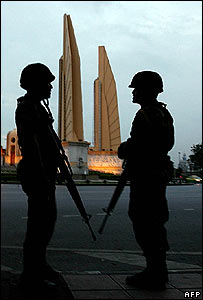 Thai soldiers on guard near Bangkok's Democracy monument