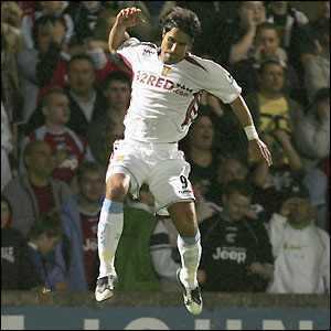 Juan Pablo Angel jumps for joy after scoring