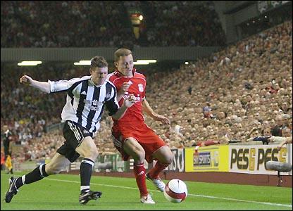 James Milner challenges Liverpool's Fabio Aurelio